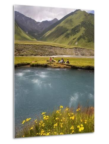 Hiking Group Resting Beside Mineral Spring in Truso Valley-Mark Daffey-Metal Print