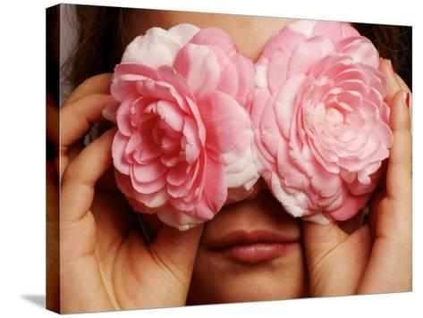 Young Girl Holding Camellia Flowers over Her Eyes-Oliver Strewe-Stretched Canvas Print