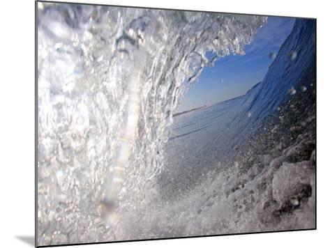 Surfer's Perspective Looking Out Barrel of Wave, at Popular Surfing Beach Playa Aserradores-Paul Kennedy-Mounted Photographic Print