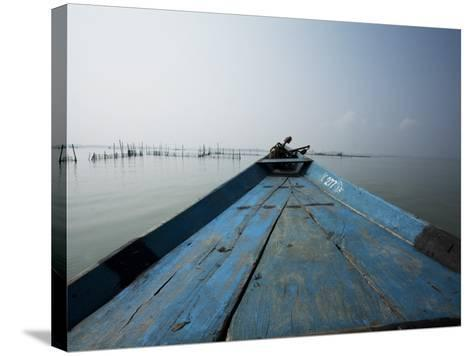 Boat on Lake with Fish Traps Ahead-April Maciborka-Stretched Canvas Print