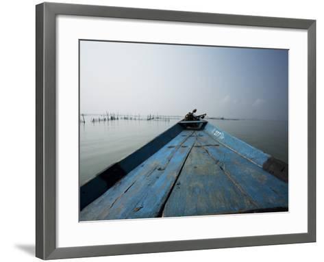 Boat on Lake with Fish Traps Ahead-April Maciborka-Framed Art Print