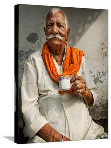 Man Drinking His Afternoon Chai-April Maciborka-Stretched Canvas Print