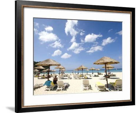 Umbrellas on Beach-Austin Bush-Framed Art Print
