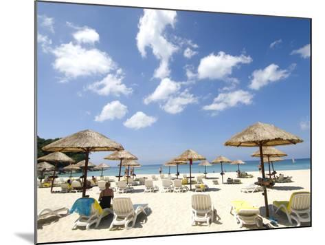 Umbrellas on Beach-Austin Bush-Mounted Photographic Print