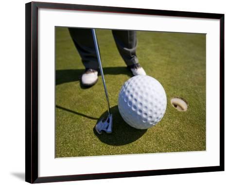 Man Playing Golf with Oversized Ball-Thomas Winz-Framed Art Print