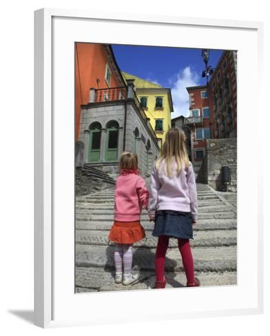Two Girls on Ulica 1 Maja Street with Colourful Buildings-Ruth Eastham & Max Paoli-Framed Art Print