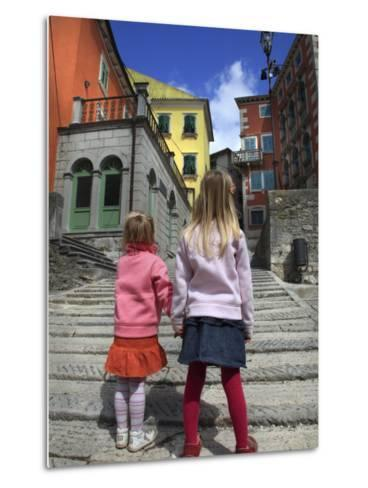 Two Girls on Ulica 1 Maja Street with Colourful Buildings-Ruth Eastham & Max Paoli-Metal Print