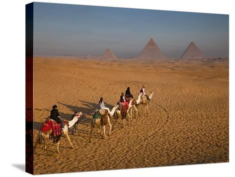 Tourists on Camels and Pyramids of Giza-Richard l'Anson-Stretched Canvas Print