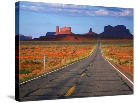 Interstate 163 Approaching Monument Valley with Sentinel Mesa in Backgound-Ruth Eastham & Max Paoli-Stretched Canvas Print