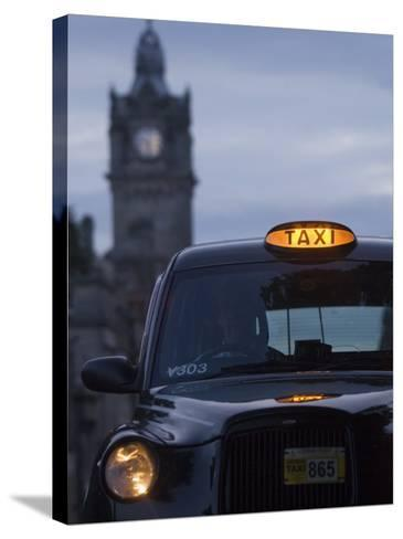 Taxi with Balmoral Hotel in Background-Will Salter-Stretched Canvas Print