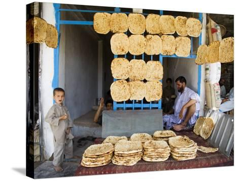 Men and Boys at Traditional Afghan Bakery-Tony Wheeler-Stretched Canvas Print