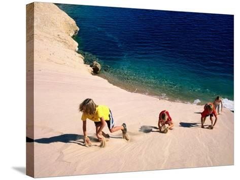 Overhead of Children Climbing Sand Dune-Philip & Karen Smith-Stretched Canvas Print