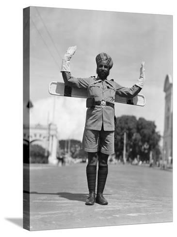 Sikh Traffic Policeman Standing in Middle of Street, Directing Traffic, Singapore-H^ Armstrong Roberts-Stretched Canvas Print