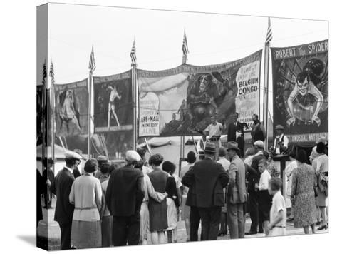 Crowd Watching Sideshow Performers in Front of Circus Posters, Outdoors-H^ Armstrong Roberts-Stretched Canvas Print