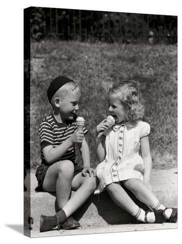 Boy and Girl Sitting on Curb, Eating Ice Cream Cones-H^ Armstrong Roberts-Stretched Canvas Print