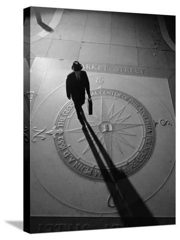 Silhouetted Businessman With Briefcase Walking Across Compass in the Sidewalk-H^ Armstrong Roberts-Stretched Canvas Print
