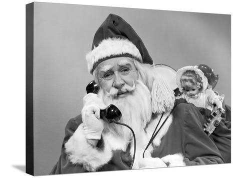 Santa Claus on the Telephone With His Sack of Toys-H^ Armstrong Roberts-Stretched Canvas Print
