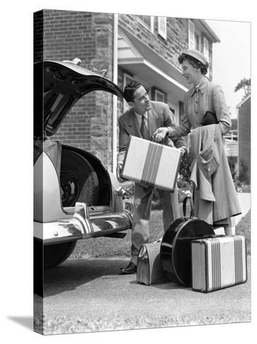 Smiling Couple Load Suitcases Into Trunk of Sedan-H^ Armstrong Roberts-Stretched Canvas Print