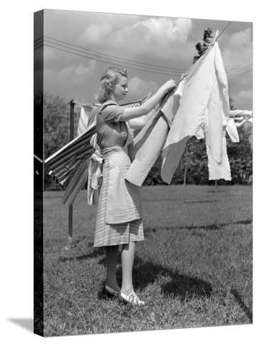 Woman, Housewife, is Outdoors, Hanging Clean Fresh Laundry on Clothesline-H^ Armstrong Roberts-Stretched Canvas Print