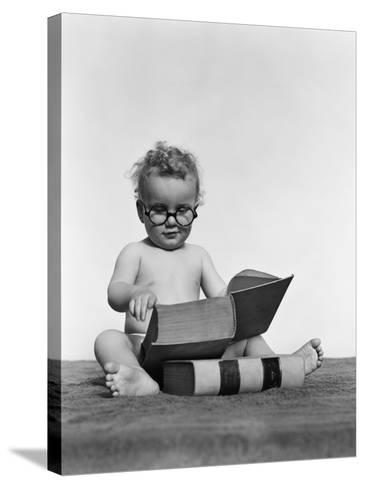 Baby Boy is Wearing Round Glasses While Reading a Very Large Book-H^ Armstrong Roberts-Stretched Canvas Print