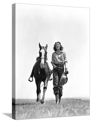 Woman Walking Beside Horse Holding Cowboy Hat in Gloved Hand-H^ Armstrong Roberts-Stretched Canvas Print