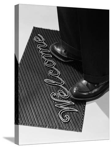 Man Stepping Onto Welcome Mat-H^ Armstrong Roberts-Stretched Canvas Print