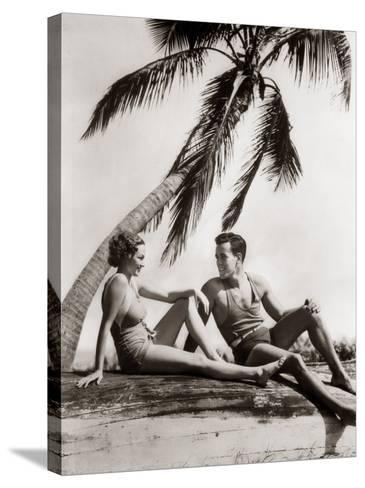 Smiling Couple Under Palm Tree Bathing-H^ Armstrong Roberts-Stretched Canvas Print