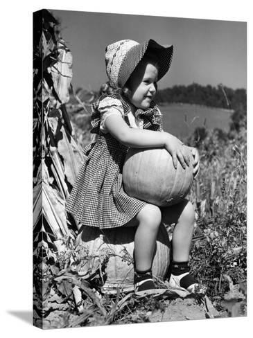 Girl Sitting on Pumpkin, Wearing Sun Bonnet-H^ Armstrong Roberts-Stretched Canvas Print