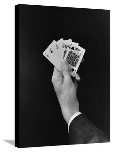Man's Hand Holding 'Full House' Poker Card Hand-H^ Armstrong Roberts-Stretched Canvas Print