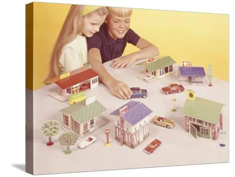 Boy and Girl (8-9) Playing With Doll Houses and Cars, Elevated View-George Marks-Stretched Canvas Print