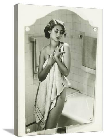 Mirror With Reflection of Woman Covering Herself With Towel in Bathroom-George Marks-Stretched Canvas Print