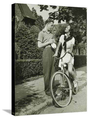 Young Couple Talking on Street, Woman on Bicycle-George Marks-Stretched Canvas Print