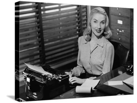 Secretary Sitting at Manual Typewriter, Portrait-George Marks-Stretched Canvas Print