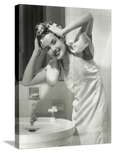 Portrait of Young Woman Washing Hair in Bathroom-George Marks-Stretched Canvas Print