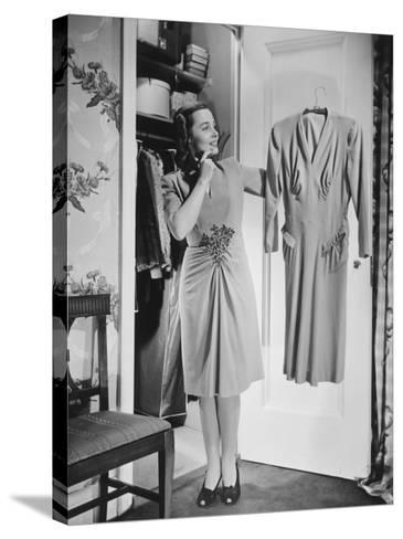 Woman Holding Dress at Opened Doors of Dressing-Room-George Marks-Stretched Canvas Print