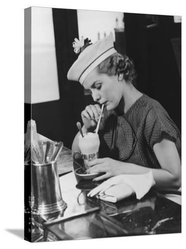 Young Woman in Fancy Hat Drinking Ice Cream Soda-George Marks-Stretched Canvas Print