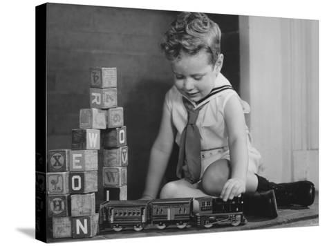 Boy (4-5) Playing With Model Train Set on Floor,-George Marks-Stretched Canvas Print