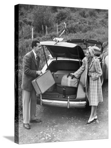 Couple Unloading Luggage From Trunk of Car-George Marks-Stretched Canvas Print