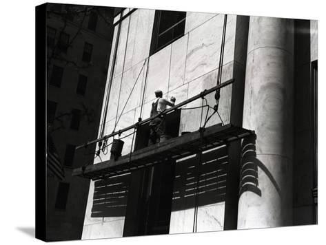 Man Working on Platform Hanging From Building-George Marks-Stretched Canvas Print