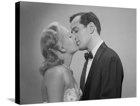 Studio Shot of Kissing Couple in Evening Wear-George Marks-Stretched Canvas Print