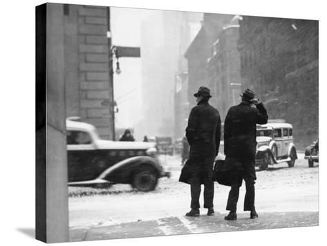 Two Men Walking on City Street in Snow-Storm-George Marks-Stretched Canvas Print