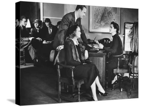 Couple Applying For Mortgage, Talking To Clerk-George Marks-Stretched Canvas Print