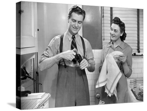Man Opening Can of Pop, Woman Drying Dishes-George Marks-Stretched Canvas Print