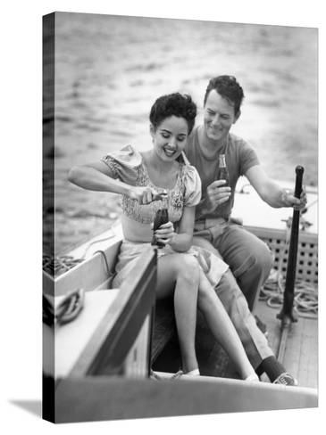 Couple on Small Sail-Boat Drinking Coke-George Marks-Stretched Canvas Print