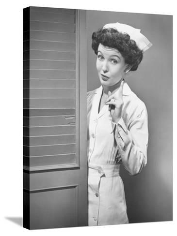Nurse Pointing at Opened Doors (B&W)-George Marks-Stretched Canvas Print