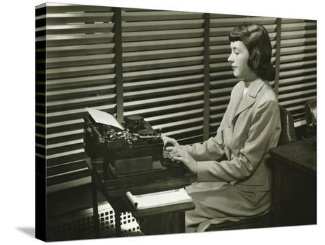 Secretary Typing on Typewriter in Office-George Marks-Stretched Canvas Print