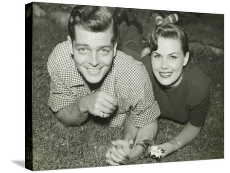 Young Couple Lying in Field, Portrait-George Marks-Stretched Canvas Print