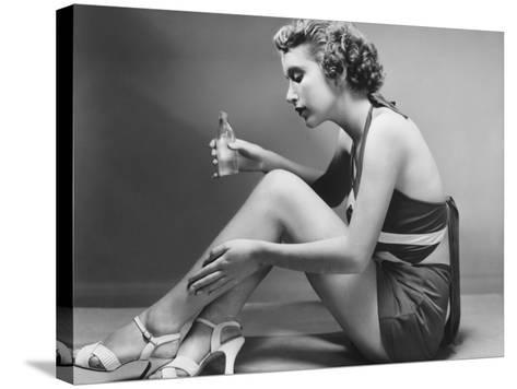 Woman Applying Cosmetic on Calf-George Marks-Stretched Canvas Print