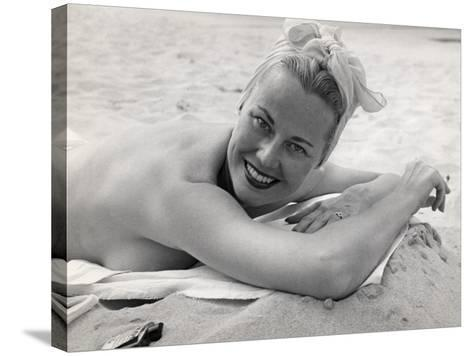 Woman Sunning and Smoking at Beach-George Marks-Stretched Canvas Print