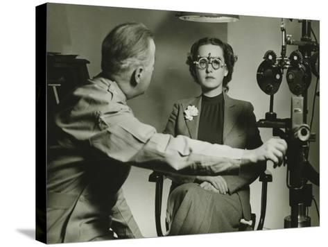 Optician Examining Patient's Eyes-George Marks-Stretched Canvas Print